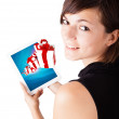 Young woman looking at modern tablet with present boxes — Stock Photo #14580641