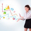 Young business woman presenting colorful charts and diagrams — Stock Photo #14581215