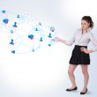 Young business woman presenting social map — Stock Photo #14581237