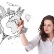 Young woman drawing a globe on whiteboard — Stock Photo #14581355
