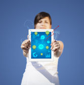 Young woman looking at modern tablet with abstract light and var — Stock Photo