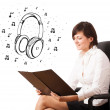 Young girl presenting headphone and musical notes - Stock Photo
