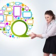 Young business woman presenting colourful speach bubble — Stock Photo