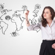 Young woman drawing a social map on whiteboard — Stock Photo #15039509