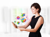 Young woman looking at modern tablet with pie charts — Stock Photo