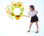 Young business woman presenting abstract copyspace — Stock Photo