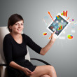 Royalty-Free Stock Photo: Woman holding modern tablet with colorful diagrams and graphs