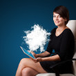 Young woman looking at modern tablet with abstract cloud — Stock Photo