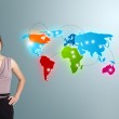 Young woman making phone call with colorful world map — Stock Photo #15767317