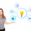 Young woman presenting light bulb with colorful graphs and diagr — Stock Photo