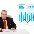Businessman sitting at desk with statistics — Stock Photo #15767617