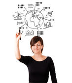 Young woman drawing globe with diagrams isolated on white — Stock Photo