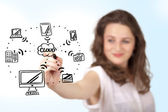 Young woman drawing a cloud computing on whiteboard — Stock Photo