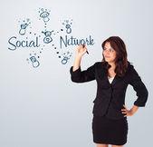 Woman draving social network theme on whiteboard — Stock Photo