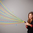 Happy girl holding a phone with colorful abstract lines — Stock Photo