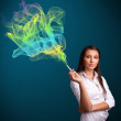 Pretty lady smoking cigarette with colorful smoke — Stock Photo