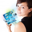 Young woman browsing pictures on modern tablet - Stock Photo