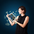 Young woman holding tablet with money - Stock Photo