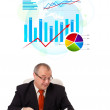 Businessman sitting at desk with statistics — Stock Photo