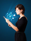 Young woman looking at modern tablet with abstract lights and so — 图库照片