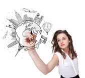 Young woman drawing a globe on whiteboard — Stock Photo