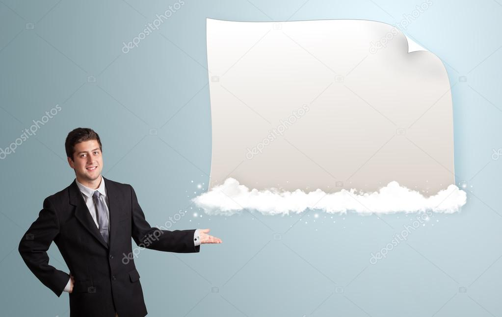 Attractive young man presenting modern copy space on clouds — Stock Photo #16641873