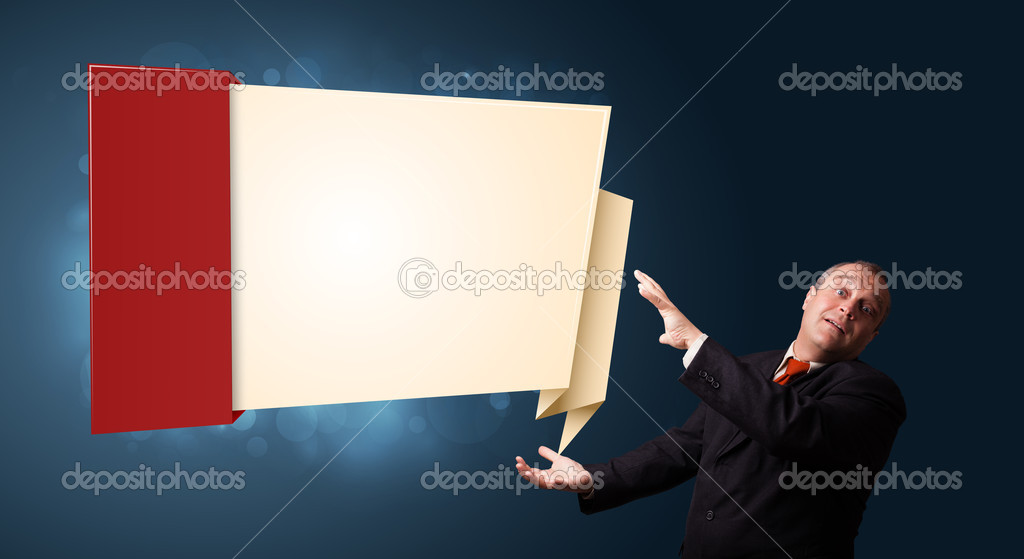 Funny businessman in suit presenting modern origami copy space — Stock Photo #16642317