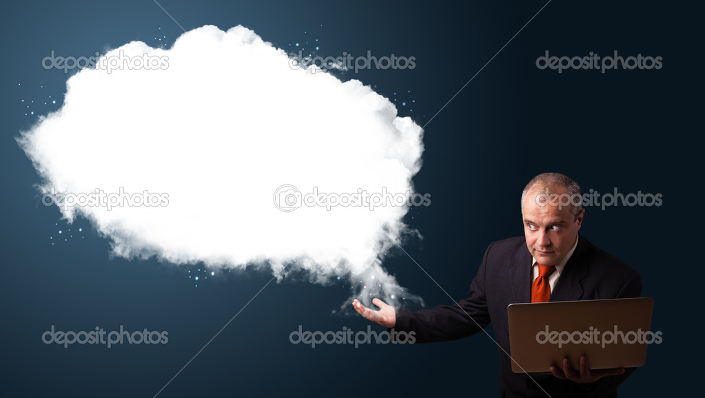 Businessman in suit holding a laptop and presenting abstract cloud copy space  Stock Photo #16642461