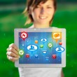 Young woman looking at modern tablet with abstract lights and so — Stock Photo