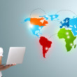 Young woman holding a laptop and presenting colorful world map — Stock Photo #18761853