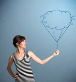 Pretty lady holding a cloud balloon drawing — Stock Photo