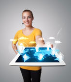 Beautiful woman holding modern tablet with social icons — Stock Photo