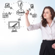 Young woman drawing a cloud computing on whiteboard — Stock Photo #19891087