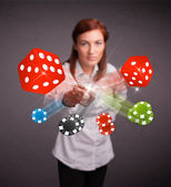 Young woman throwing dices and chips — Stock Photo