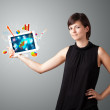 Woman holding modern tablet with colorful diagrams and graphs — Stock Photo #20128313