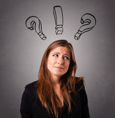 Young lady thinking with question marks overhead — Stock Photo