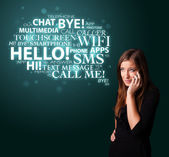 Young girl calling by phone with word cloud — Stock Photo