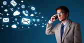 Young man making phone call with message icons — Stock Photo