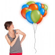 Young woman holding colorful balloons — Stock Photo