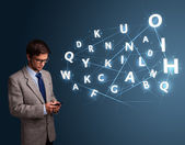 Young man typing on smartphone with high tech 3d letters comming — Stock Photo