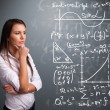 Beautiful school girl thinking about complex mathematical signs - ストック写真