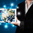 Woman presenting 3d earth globe in modern tablet — Stock Photo