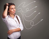 Attractive teenager looking at multiple curly arrows — Stock Photo