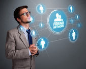 Handsome man looking at modern social network — Stock Photo