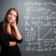 Beautiful school girl thinking about complex mathematical signs — Stock Photo #22568365