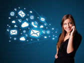 Young lady making phone call with message icons — Stock Photo