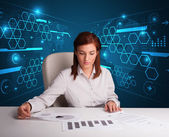 Businesswoman doing paperwork with futuristic background — Stock Photo