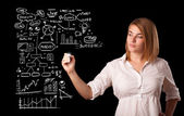 Woman drawing business scheme and icons on whiteboard — Stock Photo