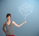 Happy woman holding smiling balloons drawing — Foto Stock