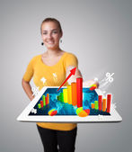 Young woman holding tablet with colorful graphs and diagrams — Stock Photo